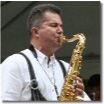 Jurgen Schwarze plays horns with the Express band
